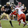 "Nelson Spruce of CU, looks for room to run against Utah.<br /> For more photos of the CU game, go to  <a href=""http://www.dailycamera.com"">http://www.dailycamera.com</a><br /> Cliff Grassmick / November 23, 2012"