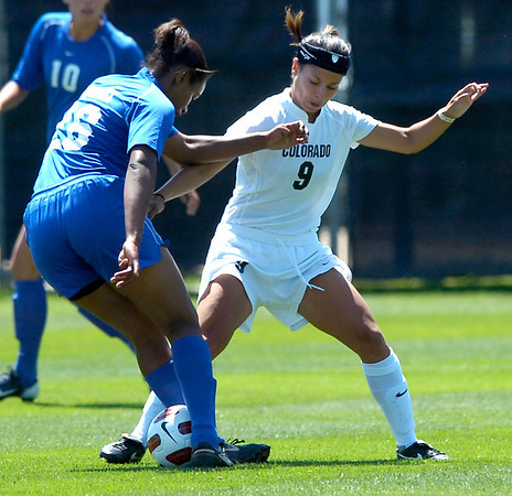 CU's #9 Kym Lowry, right, tries to strip the ball from #26 Pittany White during the University of Colorado vs Air Force soccer game at Prentup Field in Boulder on Sunday August 15. <br /> Photo by Paul Aiken / The Camera
