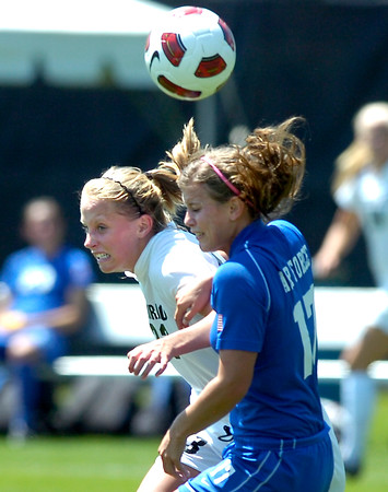 CU's #23 Anne Stuller, left, bangs bodies with #17 Kristi Whiteman trying to control the ball during the University of Colorado vs Air Force soccer game at Prentup Field in Boulder on Sunday August 15. <br /> Photo by Paul Aiken / The Camera