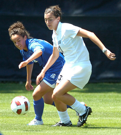 CU's #13 Kate Russell, right, battles for the ball against #16 Sophia Lockerby, during the University of Colorado vs Air Force soccer game at Prentup Field in Boulder on Sunday August 15. <br /> Photo by Paul Aiken / The Camera