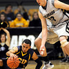 Colorado Christian's Anthony Urrutia (left) tries to regain control of the ball while being pressured by Colorado's Shane Harris-Tunks (right) during their basketball game at the University of Colorado in Boulder, Colorado December 7, 2009.  CAMERA/Mark Leffingwell