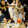 Colorado's Cory Higgins (right) steals the ball from Colorado Christian's Rye Olson (left) during their basketball game at the University of Colorado in Boulder, Colorado December 7, 2009.  CAMERA/Mark Leffingwell
