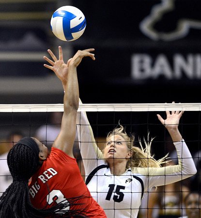 Nikki Lindow (15) of the University of Colorado volleyball team goes up for a block against Janel Forte (3) during their game against the Cornell Big Red at the Coors Event Center on Friday August 31, 2012. For more photos of the game go to www. buff zone.com.<br /> Photo by Paul Aiken / The Daily Camera