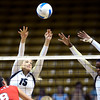 Nikki Lindow (15) and Alexis Austin (3) of the University of Colorado volleyball team go up for a block against Breanna Wong (8) during their game against the Cornell Big Red at the Coors Event Center on Friday August 31, 2012. For more photos of the game go to www. buff zone.com.<br /> Photo by Paul Aiken / The Daily Camera