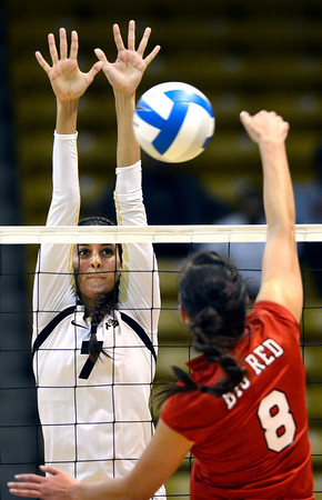 Neira Ortiz Ruiz (7) of the University of Colorado volleyball team goes up for a block against Breanna Wong (8) during their game against the Cornell Big Red at the Coors Event Center on Friday August 31, 2012. For more photos of the game go to www. buff zone.com.<br /> Photo by Paul Aiken / The Daily Camera
