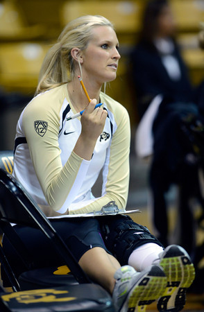 An injured Kerra Schroeder (6) of the University of Colorado volleyball team watches from the sidelines during their game against the Cornell Big Red at the Coors Event Center on Friday August 31, 2012. For more photos of the game go to www. buff zone.com.<br /> Photo by Paul Aiken / The Daily Camera