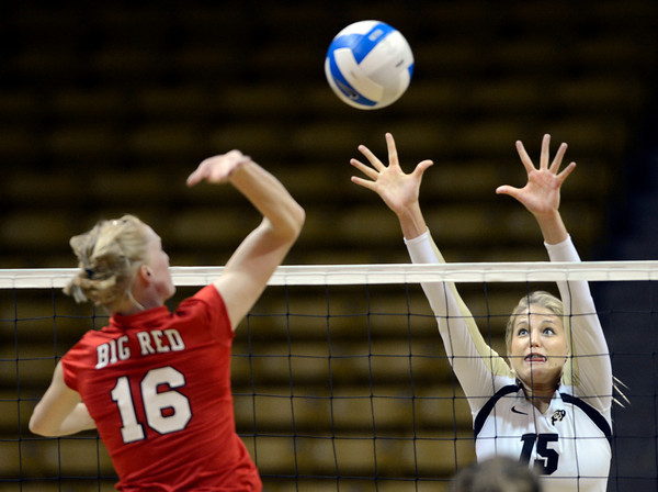 Nikki Lindow (15) of the University of Colorado volleyball team goes up for a block against Rachel D'Epagnier (16) during their game against the Cornell Big Red at the Coors Event Center on Friday August 31, 2012. For more photos of the game go to www. buff zone.com.<br /> Photo by Paul Aiken / The Daily Camera