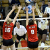 Alexis Austin (3)of the University of Colorado volleyball team makes a shot against RAchel D'Epagnier (16) and Breanna Wong (8) during their game against the Cornell Big Red at the Coors Event Center on Friday August 31, 2012. For more photos of the game go to www. buff zone.com.<br /> Photo by Paul Aiken / The Daily Camera