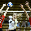 Nikki Lindow (15) of the University of Colorado volleyball team makes a shot against Rachel D'Epagnier (16) and Breanna Wong (8) during their game against the Cornell Big Red at the Coors Event Center on Friday August 31, 2012. For more photos of the game go to www. buff zone.com.<br /> Photo by Paul Aiken / The Daily Camera