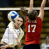 Kelsy English (1) of the University of Colorado volleyball team makes a shot against Kelly Marble (17) during their game against the Cornell Big Red at the Coors Event Center on Friday August 31, 2012. For more photos of the game go to www. buff zone.com.<br /> Photo by Paul Aiken / The Daily Camera