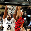 """Andre Roberson, (21)of the University of Colorado Buffaloes goes to the basket against Tyler Johnson (1) Fresno State Bulldogs during their game in Boulder Colo. on Wednesday December 7, 2011.   Photo by Paul Aiken / The Boulder Camera / December 7, 2011<br /> For more photos go to  <a href=""""http://www.buffzone.com"""">http://www.buffzone.com</a>"""