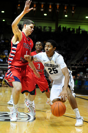"The University of Colorado Buffaloes Spencer Dinwiddie (25) drives to the basket past Tyler Johnson (1) of the Fresno State Bulldogs during their game in Boulder Colo. on Wednesday December 7, 2011.   Photo by Paul Aiken / The Boulder Camera / December 7, 2011<br /> For more photos go to  <a href=""http://www.buffzone.com"">http://www.buffzone.com</a>"