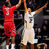 "University of Colorado Buffalo Spencer Dinwiddie (25) tries to block a shot by Kevin Olekaibe (3) of the Fresno State Bulldogs during their game in Boulder Colo. on Wednesday December 7, 2011.   Photo by Paul Aiken / The Boulder Camera / December 7, 2011<br /> For more photos go to  <a href=""http://www.buffzone.com"">http://www.buffzone.com</a>"