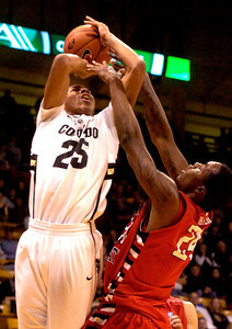 Spencer Dinwiddie (25) of the University of Colorado Buffaloes battles with Kevin Foster (24) of the Fresno State Bulldogs during their game in Boulder Colo. on Wednesday December 7, 2011.   Photo by Paul Aiken / The Boulder Camera / December 7, 2011 For more photos go to www.buffzone.com