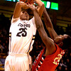 """Spencer Dinwiddie (25) of the University of Colorado Buffaloes battles with Kevin Foster (24) of the Fresno State Bulldogs during their game in Boulder Colo. on Wednesday December 7, 2011.   Photo by Paul Aiken / The Boulder Camera / December 7, 2011<br /> For more photos go to  <a href=""""http://www.buffzone.com"""">http://www.buffzone.com</a>"""