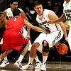"""Shane Harris-Tunks (15)  of the University of Colorado Buffaloes dribbles behind his back to work around Tyler Johnson (1) of the Fresno State Bulldogs during their game in Boulder Colo. on Wednesday December 7, 2011.   Photo by Paul Aiken / The Boulder Camera / <br /> For more photos go to  <a href=""""http://www.buffzone.com"""">http://www.buffzone.com</a>"""