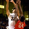 """Sabatino Chen, (23) of the University of Colorado Buffaloes goes up against Kevin Foster (24) of the Fresno State Bulldogs during their game in Boulder Colo. on Wednesday December 7, 2011.   Photo by Paul Aiken / The Boulder Camera / December 7, 2011<br /> For more photos go to  <a href=""""http://www.buffzone.com"""">http://www.buffzone.com</a>"""