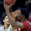 Colorado guard Andre Roberson, left, pressures Iowa State forward Calvin Godfrey (15) during the first half of an NCAA college basketball game in the first round of the Big 12 men's basketball tournament Wednesday, March 9, 2011 in Kansas City, Mo. (AP Photo/Charlie Riedel)