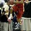 Iowa State guard Darion 'Jake' Anderson (5) leaps to save a ball from going out of bounds during the second half of an NCAA college basketball game against Colorado in the first round of the Big 12 Men's Basketball tournament Wednesday, March 9, 2011 in Kansas City, Mo. Colorado won the game 77-75. (AP Photo/Charlie Riedel)