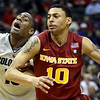 Colorado guard Alec Burks, left, pressures Iowa State guard Diante Garrett (10) during the second half of an NCAA college basketball game in the first round of the Big 12 Men's Basketball tournament Wednesday, March 9, 2011 in Kansas City, Mo. Colorado won the game 77-75. (AP Photo/Charlie Riedel)