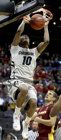Colorado guard Alec Burks (10) gets past Iowa State guard Scott Christopherson (11) to dunk the ball during the first half of an NCAA college basketball game in the first round of the Big 12 coference tournament Wednesday, March 9, 2011 in Kansas City, Mo. (AP Photo/Charlie Riedel)