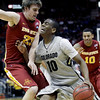 Colorado guard Alec Burks (10) is pressured by Iowa State forward Jamie Vanderbeken (23) as he goes up for a shot during the first half of an NCAA college basketball game in the first round of the Big 12 coference tournament Wednesday, March 9, 2011 in Kansas City, Mo. (AP Photo/Charlie Riedel)