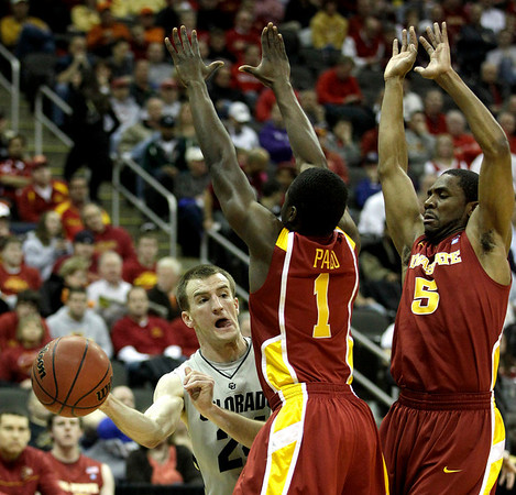 Colorado guard Levi Knutson, left, passes around Iowa State guards Bubu Palo (1) and Darion 'Jake' Anderson (5) during the first half of an NCAA college basketball game in the first round of the Big 12 Men's Basketball tournament Wednesday, March 9, 2011 in Kansas City, Mo. (AP Photo/Charlie Riedel)