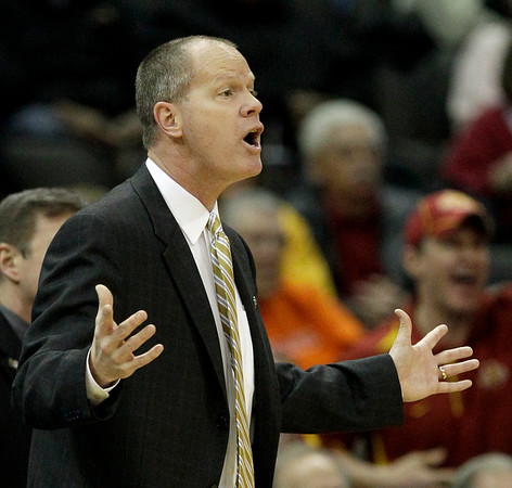 Colorado coach Tad Boyle questions a call during the first half of an NCAA college basketball game against Iowa State in the first round of the Big 12 Men's Basketball tournament Wednesday, March 9, 2011 in Kansas City, Mo. (AP Photo/Charlie Riedel)
