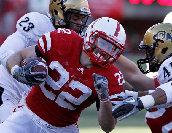 Nebraska running back Rex Burkhead (22) carries the ball against Colorado cornerbacks Jalil Brown (23) and Terrel Smith (41) during the first half of an NCAA college football game, in Lincoln, Neb., Friday, Nov. 26, 2010. (AP Photo/Nati Harnik)