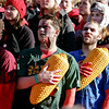 "Nebraska fans hold their corn hats to their chests during the singing of the ""Star Spangled Banner"" prior to an NCAA college football game against Colorado, in Lincoln, Neb., Friday, Nov. 26, 2010. (AP Photo/Nati Harnik)"