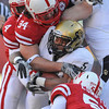 Colorado running back Rodney Stewart (5) is smothered by Nebraska linebacker Will Compton (51), defensive end Cameron Meredith (34) and linebacker Lavonte David (4), in the first half of an NCAA college football game, in Lincoln, Neb., Friday, Nov. 26, 2010. (AP Photo/Dave Weaver)