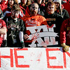 "Nebraska fans dress in jerseys of Big 12 teams and stand over a sign reading ""The End is Near"", prior to Nebraska's last home game against a Big 12 conference foe, Colorado, in an NCAA college football in Lincoln, Neb., Friday, Nov. 26, 2010. (AP Photo/Nati Harnik)"