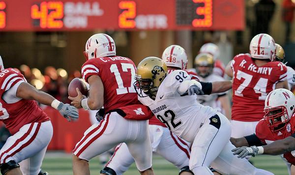 COLORADO VS. NEBRASKA, LINCOLN, NEB -11/26/2010 - Colorado defensive end Forrest West (92) gets to Nebraska quarterback Cody Green (17) in second quarter action at Memorial Stadium, Friday, November 26, 2010.  (TED KIRK/Lincoln Journal Star)