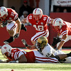 Nebraska running back Rex Burkhead (22) leaps over teammate, offensive linesman Keith Williams (68), with Kyler Reed (25) and Tyler Legate (48), as Colorado linebacker Liloa Nobriga (48) is on the ground, during the first half of an NCAA college football game, in Lincoln, Neb., Friday, Nov. 26, 2010. (AP Photo/Dave Weaver)