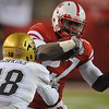 Nebraska's Dontrayevous Robinson (27) tries to get by Colorado's Jonathan Hawkins (18) during an NCAA college football game Friday Nov 26, 2010, in Lincoln, Neb. (AP Photo/Dave Weaver)
