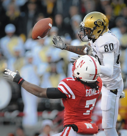 Nebraska's DeJon Gomes (7) grabs an interception in front of Colorado's Paul Richardson (80) during their  NCAA college football game Friday Nov 26, 2010, in Lincoln, Neb. (AP Photo/Dave Weaver)