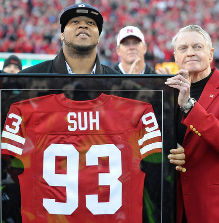 Detroit Lions rookie Ndamukong Suh, left, and Nebraska athletic director Tom Osborne, right, participate in a ceremony to retire Suh's No. 93 jersey, during a halftime ceremony at the Colorado-Nebraska game in Lincoln, Neb., Friday, Nov. 26, 2010. (AP Photo/Dave Weaver)
