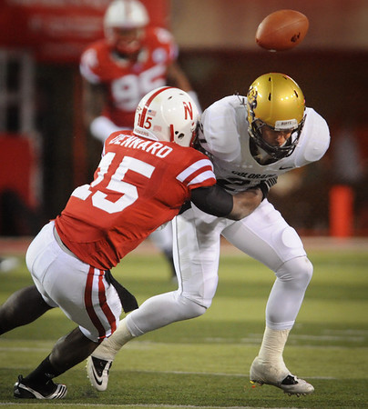 Nebraska's Alfonzo Dennard (15) forces a fumble by Colorado's Scotty McKnight (21) during their  NCAA college football game Friday, Nov. 26, 2010, in Lincoln, Neb. (AP Photo/Dave Weaver)
