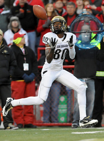 Colorado wide receiver Paul Richardson (80) catches a pass from quarterback Cody Hawkins and goes on to score a touchdown in the second half of an NCAA college football game against Nebraska, in Lincoln, Neb., Friday, Nov. 26, 2010. Nebraska beat Colorado 45-17. (AP Photo/Dave Weaver)