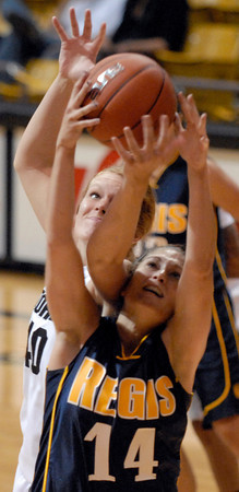 20111106_CU_REGIS_9.jpg CU's Rachel Hargis fouls Regis' Meghan Hollenga during the second half Sunday afternoon Nov. 06, 2011 at the Coors Events Center. (Lewis Geyer/Times-Call)