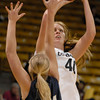 TCstudent006.JPG CU's Rachel Hargis takes a shot in front of Regis' Kara Larson during the first half Sunday afternoon Nov. 06, 2011 at the Coors Events Center. (Lewis Geyer/Times-Call)