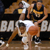 TCstudent004.JPG CU's Brittany Wilson lets the ball getaway against Regis during the first half Sunday afternoon Nov. 06, 2011 at the Coors Events Center. (Lewis Geyer/Times-Call)