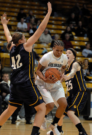 TCstudent003.JPG CU's Chucky Jeffery moves the ball between Regis' Kari Ameling, left, and Nicole Brzeczek during the first half Sunday afternoon Nov. 06, 2011 at the Coors Events Center. (Lewis Geyer/Times-Call)