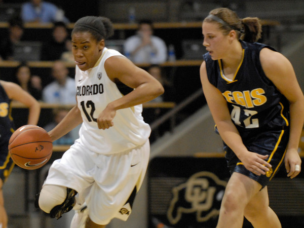 TCstudent005.JPG CU's Ashley Wilson moves the ball past Regis' Kari Ameling during the first half Sunday afternoon Nov. 06, 2011 at the Coors Events Center. (Lewis Geyer/Times-Call)