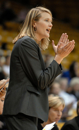 20111106_CU_REGIS_10.jpg CU coach Linda Lappe applauds a shot made by Chucky Jeffery in the second half against Regis Sunday afternoon Nov. 06, 2011 at the Coors Events Center. (Lewis Geyer/Times-Call)