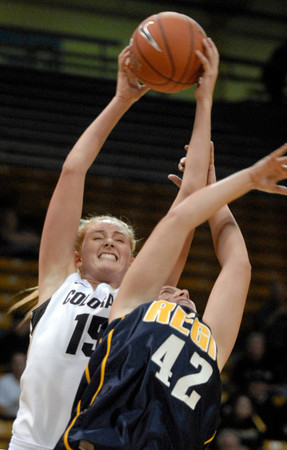 TCstudent008.JPG CU's Julie Seabrook grabs an offensive rebound from Regis' Kari Ameling during the first half Sunday afternoon Nov. 06, 2011 at the Coors Events Center. (Lewis Geyer/Times-Call)