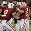Stanford wide receiver Griff Whalen (17), right, and quarterback Andrew Luck (12), left, celebrate after Whalen scored against Colorado in the fourth quarter of an NCAA college football game in Stanford, Calif., Saturday, Oct. 8, 2011. (AP Photo/Paul Sakuma)
