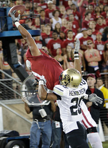 Stanford tight end Levine Toilolo (11) is unable to catch a pass in the end zone in front of Colorado defensive back Greg Henderson (20) in the third quarter of an NCAA college football game in Stanford, Calif., Saturday, Oct. 8, 2011. (AP Photo/Paul Sakuma)