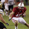 Stanford wide receiver Griff Whalen (17) eludes Colorado Jason Espinoza (15) to score a touchdown in the fourth quarter of an NCAA college football game in Stanford, Calif., Saturday, Oct. 8, 2011. (AP Photo/Paul Sakuma)