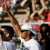Golfer Tiger Woods celebrates at Stanford score against Colorado during the first quarter of an NCAA college football game between Stanford and Colorado in in Stanford, Calif., Saturday, Oct. 8, 2011. (AP Photo/Paul Sakuma)